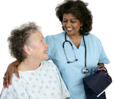 nurse giving a cup of tea to an elderly woman