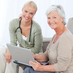 Caregiver hand senior using laptop